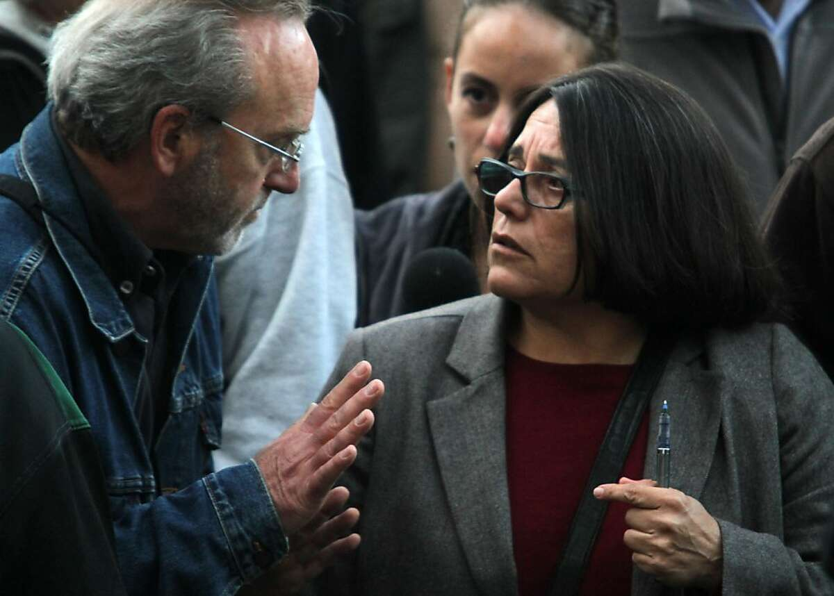 Director of the Department of Public Health Barbara Garcia talks with Richard Kreidler of Occupy San Francisco during an inspection of the encampment on Thursday, Nov. 17, 2011.