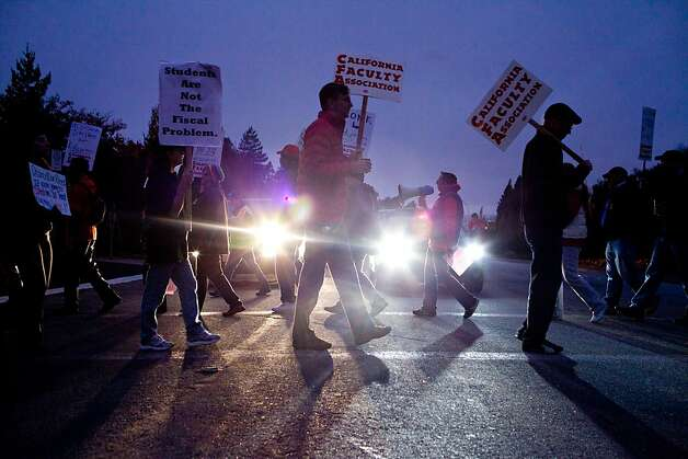California State University faculty, staff and supporters picket pre-dawn on Carlos Bee Boulevard at CSU in Hayward Thursday November 17, 2011, as part of a strike protesting for faculty pay adjustments.  Jason Henry/Special to The Chronicle Photo: Jason Henry, Special To The Chronicle