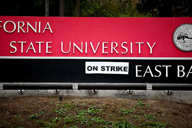 "A sign reading ""on strike"" affixed to the main entrance of California State University during a picket protest on Carlos Bee Boulevard at CSU in Hayward Thursday November 17, 2011, as part of a strike protesting for faculty pay adjustments.  Jason Henry/Special to The Chronicle Photo: Jason Henry, Special To The Chronicle"