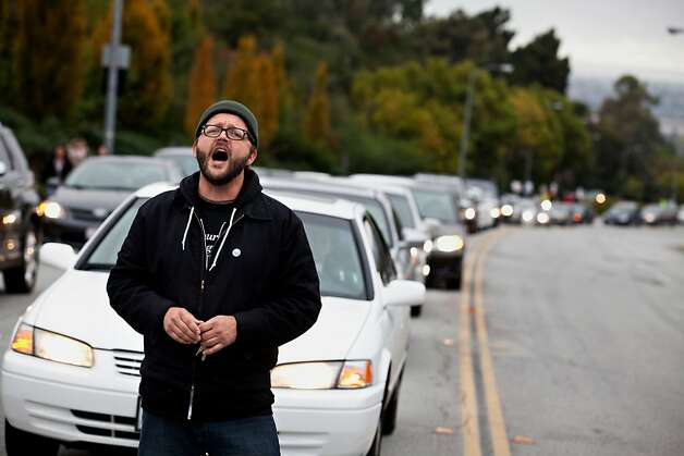 Kevin Christensen, a supporter, chants while holding up traffic on Carlos Bee Boulevard at CSU in Hayward Thursday November 17, 2011, as part of a strike protesting for faculty pay adjustments.  Jason Henry/Special to The Chronicle Photo: Jason Henry, Special To The Chronicle