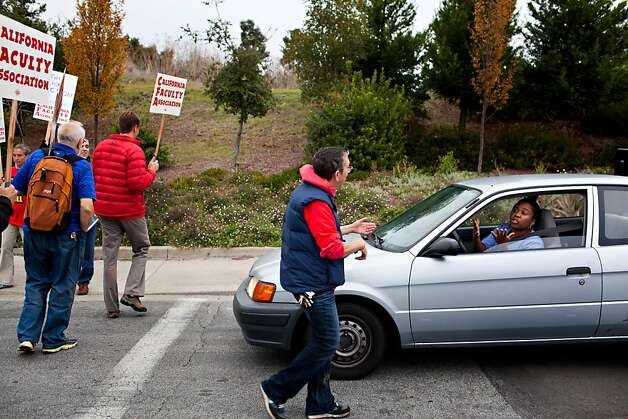 A motorists shows frustration while trying to pass the picket line on Carlos Bee Boulevard at CSU in Hayward Thursday November 17, 2011, as part of a strike protesting for faculty pay adjustments.  Jason Henry/Special to The Chronicle Photo: Jason Henry, Special To The Chronicle