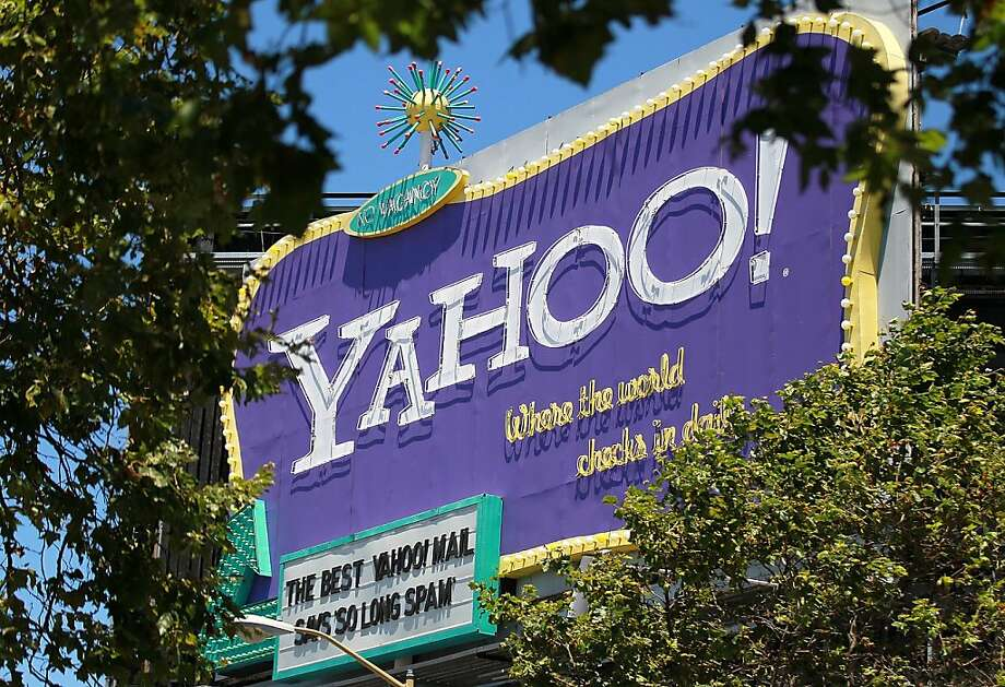 SAN FRANCISCO, CA - FILE:  A  Yahoo! billboard is visible through trees on July 19, 2011 in San Francisco, California. . It was reported that ABC News and Yahoo! News will launch a strategic online news alliance that will deliver content to more than 100 million U.S. users each month October 3, 2011. (Photo by Justin Sullivan/Getty Images)  Ran on: 10-11-2011 Yahoo shares rose as more news emerged of potential buyers. Photo: Justin Sullivan, Getty Images