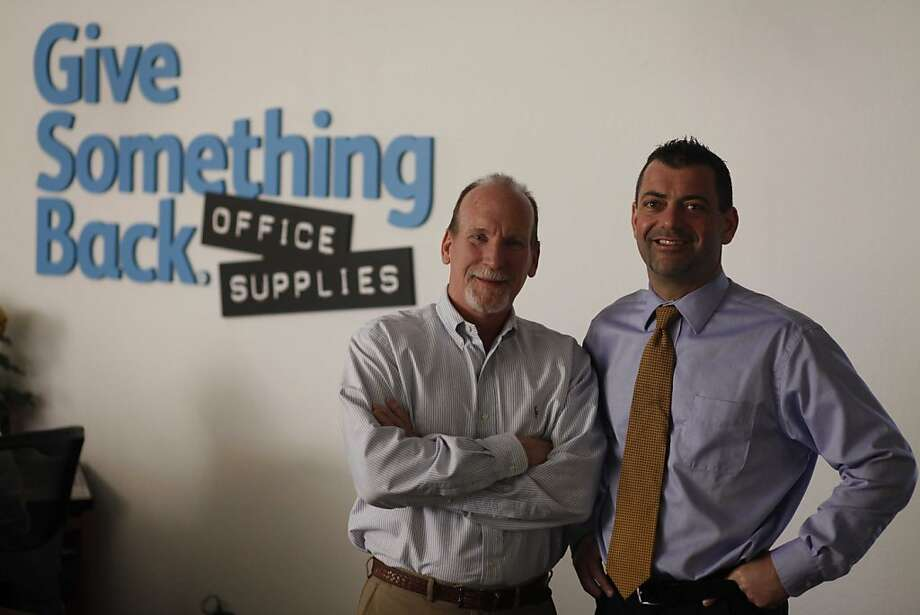 Co-founders Mike Hannigan and Sean Marx stand for a portrait at the Give Something Back headqurers on Monday Feb. 7, 2011 in Oakland, Calif.  Give Something Back is the largest independent officer supplier on the West Coast and they donate the bulk of their profits to charities. This year they celebrate 20 years in business and are expanding to Sacramento and San Diego.   Ran on: 02-14-2011 Mike Hannigan (left) and Sean Marx, co-founders of Give Something Back, an independent office supplier in Oakland, have donated the bulk of their profit to charities and nonprofits for 20 years. Photo: Mike Kepka, The Chronicle