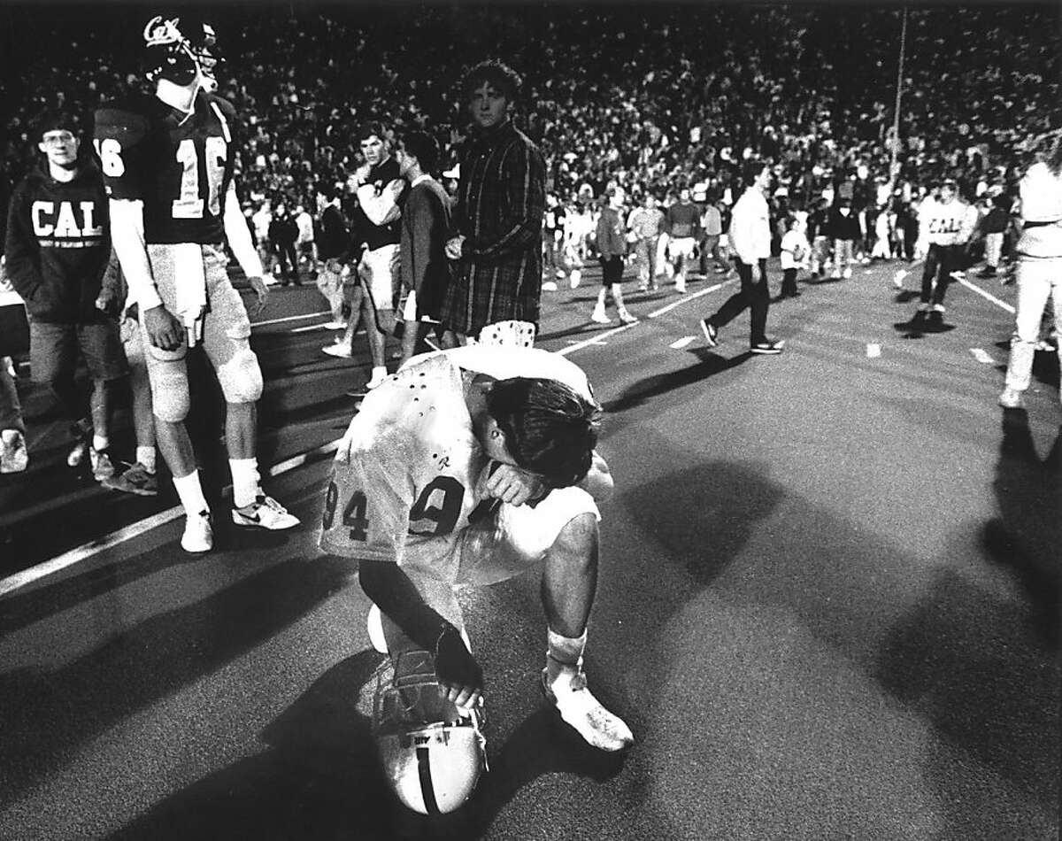 BIGGAME-1990/B/13NOV97/MN/SS--Stanford Placekicker John Hopkins (94) kneels and reflects on his game-winning field goal that beat Cal 27-25 in the November 17, 1990 Big Game. CHRONICLE PHOTO BY SCOTT SOMMERDORF Ran on: 11-18-2010 Despite how it looks, Stanford's John Hopkins is actually kneeling in celebration after beating Cal with a 39-yard field goal. Ran on: 11-18-2010 Despite how it looks, Stanford's John Hopkins is actually kneeling in celebration after beating Cal with a 39-yard field goal.