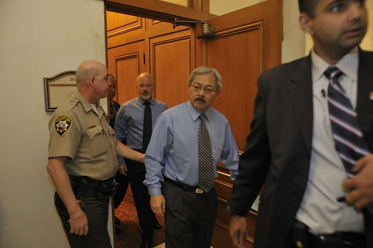 Mayor Ed Lee emerges from a city hall meeting with city officials and representatives of Occupy SF about health and legal issues surrounding the protests.