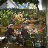 A couple enjoys lunch in the courtyard patio at the Sausalito Gourmet Deli.