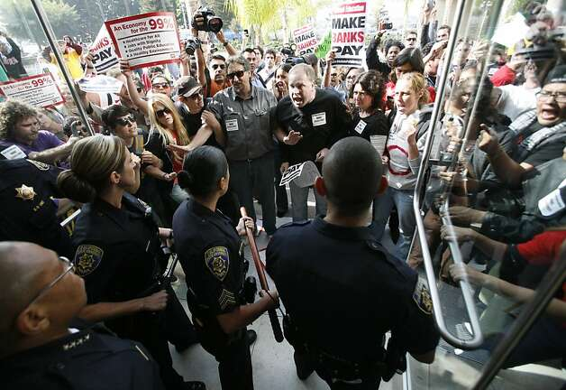 Protestors confronted California State University police after being ejected from the university's board of trustees meeting in Long Beach, California on Wednesday, November 16, 2011. (Bob Chamberlin/Los Angeles Times/MCT) Photo: Bob Chamberlin, MCT