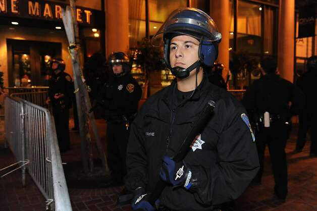 Police are seen at Occupy San Francisco on November 16, 2011.  Earlier they had come in and raided 15 tents on Market Street. Photo: Susana Bates, Special To The Chronicle
