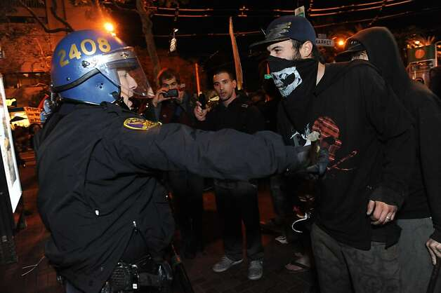 A police officer and a protester clash at Occupy San Francisco on November 16, 2011. Earlier in the morning the police came in and raided 15 tents for unlawful camping on Market Street. Photo: Susana Bates, Special To The Chronicle
