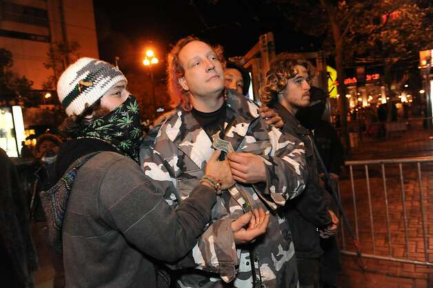 Protesters are seen at Occupy San Francisco on November 16, 2011. Earlier in the morning the police came in and raided 15 tents for unlawful camping on Market Street. Photo: Susana Bates, Special To The Chronicle