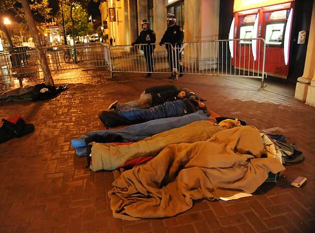 People are asleep on Market Street at Occupy San Francisco on November 16, 2011. Earlier in the morning the police came in and raided 15 tents on this block for unlawful camping Photo: Susana Bates, Special To The Chronicle