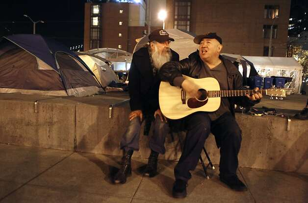 Two Occupy San Francisco protestors serenade each other Tuesday night November 15, 2011 at Justin Herman Plaza. Photo: Lance Iversen, The Chronicle