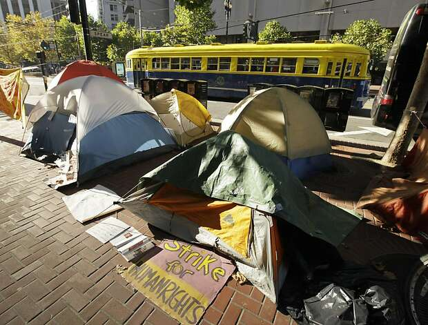 "A streetcar passes an Occupy SF encampment set up along Market Street in San Francisco, Tuesday, Nov. 15, 2011. San Francisco Mayor Ed Lee visited the encampment Tuesday and said he was –a little disappointed"" with the conditions there. (AP Photo/Eric Risberg) Ran on: 11-16-2011 At least 39 tents stand outside the main Justin Herman camp. At least 39 tents have been pitched on Market Street.    Ran on: 11-16-2011 At least 39 tents stand outside the main Justin Herman camp. At least 39 tents have been pitched on Market Street.    Ran on: 11-16-2011 At least 39 tents stand outside the main Justin Herman camp. At least 39 tents have been pitched on Market Street.    Ran on: 11-16-2011 At least 39 tents stand outside the main Justin Herman camp. At least 39 tents have been pitched on Market Street.    Ran on: 11-16-2011 At least 39 tents stand outside the main Justin Herman camp. At least 39 tents have been pitched on Market Street.    Ran on: 11-16-2011 At least 39 tents stand outside the main Justin Herman camp. At least 39 tents have been pitched on Market Street.    Photo: Eric Risberg, AP"