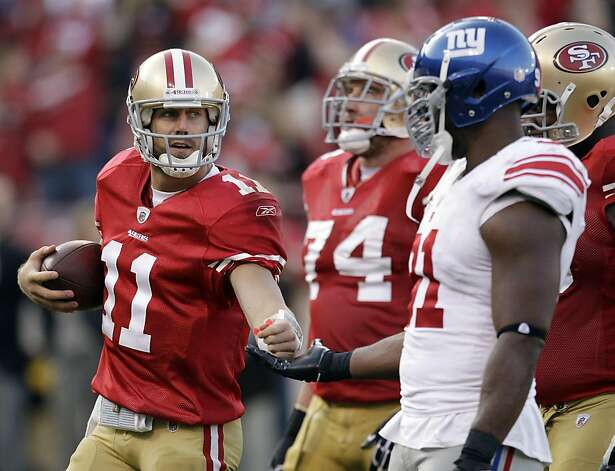 San Francisco 49ers quarterback Alex Smith (11) slaps hands with New York Giants defensive end Justin Tuck (91) at the end of an NFL football game in San Francisco, Sunday, Nov. 13, 2011. The 49ers beat the Giants 27-20. (AP Photo/Ben Margot) Photo: Ben Margot, AP