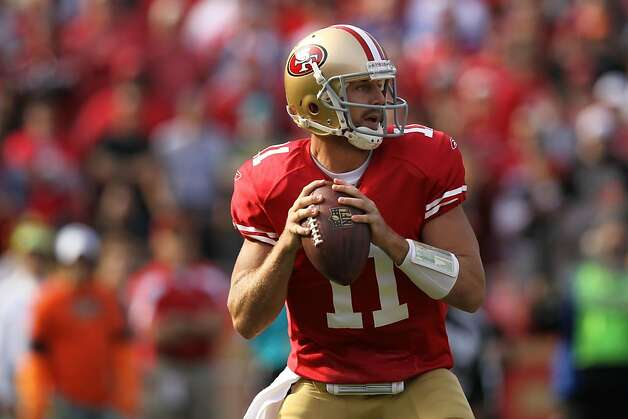 SAN FRANCISCO, CA - NOVEMBER 13:  Alex Smith #11 of the San Francisco 49ers looks to pass against the New York Giants at Candlestick Park on November 13, 2011 in San Francisco, California.  (Photo by Ezra Shaw/Getty Images) Photo: Ezra Shaw, Getty Images
