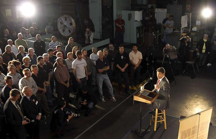 Republican presidential candidate, Texas Gov. Rick Perry, speaks to employees during a campaign stop at Granite State Manufacturing, Wednesday, Nov. 16, 2011 in Manchester, N.H. (AP Photo/Jim Cole) Ran on: 11-17-2011 Texas Gov. Rick Perry speaks to employees during a campaign stop at Granite State Manufacturing in Manchester, N.H. Photo: Jim Cole, AP
