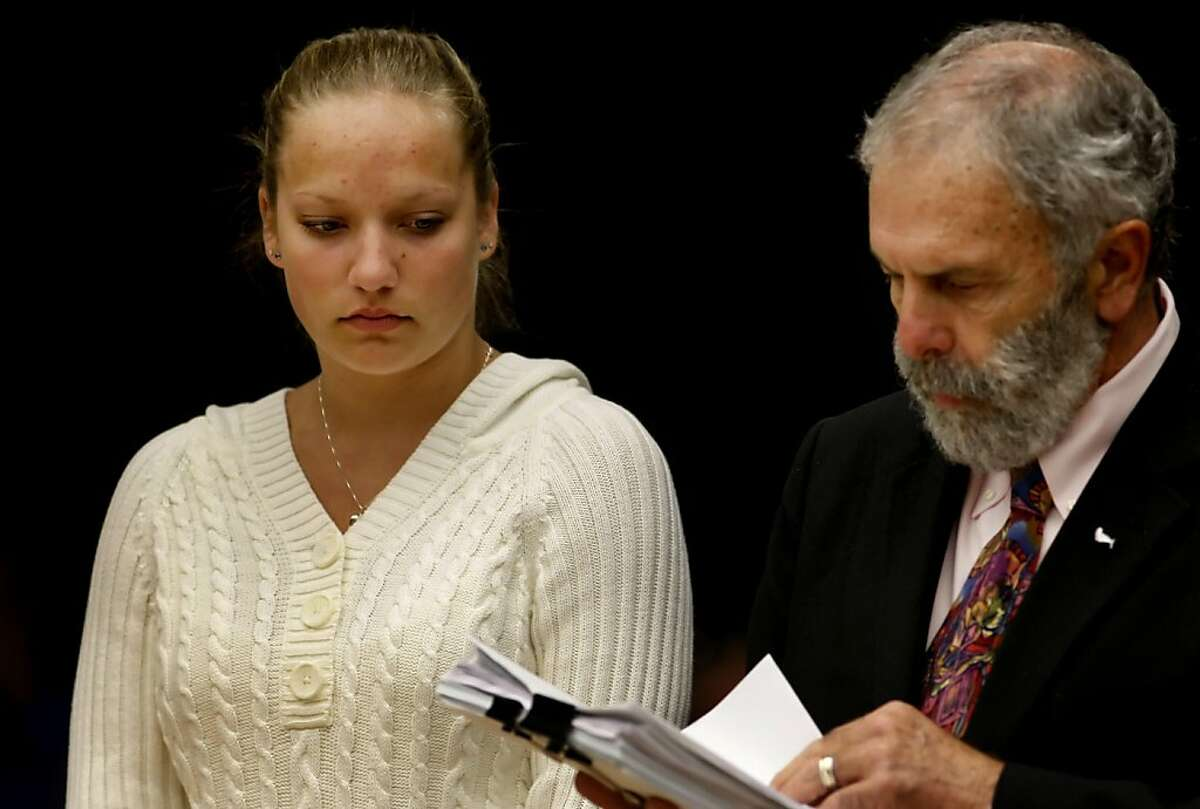 Kaitlyn Dunaway, 18 years old, stands with her attorney Chris Andrian to address the judge in a misdemeanor vehicular manslaughter charge case, Thursday May 19, 2011, at the Sonoma County Superior Court House in Santa Rosa, Calif. She was allegedly texting while driving and ran over and killed 2-year-old Calli Murray in Rohnert Park , December 1, 2010.