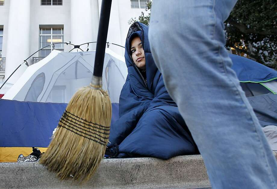 UC Berkeley student, Zoila Lara-Cera keeps warm after camping out overnight,  as the Occupy Cal encampment continues to grow in front of Sproul Hall on the UC Berkeley campus, on Wednesday November 16, 2011 in Berkeley, Ca. Photo: Michael Macor, The Chronicle