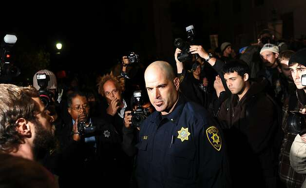 UC Berkeley police Lt. Eric Tejada warns Occupy Cal protesters that camping on campus is illegal on Wednesday, Nov. 16, 2011, in Berkeley, Calif. Following a daylong strike, about 75 people ended up camping on the steps of UC Berkeley's administration building. Photo: Noah Berger, Special To The Chronicle