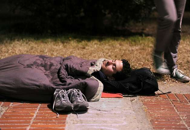Occupy Cal protester Christopher Anderson, a UC Berkeley senior, sleeps on Sproul Plaza in the early hours of Wednesday, Nov. 16, 2011, in Berkeley, Calif. Following a daylong strike, about 75 people camped out on the step's of UC Berkeley's administration building. Photo: Noah Berger, Special To The Chronicle