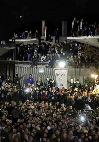 Dozens of people took to the roof of the cafeteria building  from Occupy Cal, on Tuesday November 15, 2011 in Berkeley, Ca., as they gathered for a general assembly and rally this evening, in front of Sproul Hall on the UC Berkeley campus. Photo: Michael Macor, The Chronicle