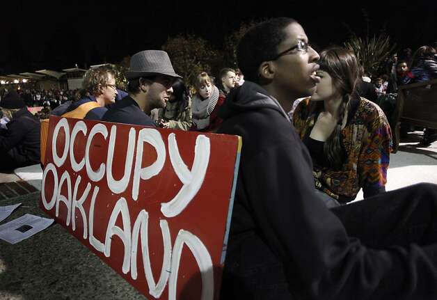 Julion Lewis-Tatman of Occupy Oakland marched five miles up Telegraph Blvd., with his sign, on Tuesday November 15, 2011 to Berkeley, Ca., to join Occupy Cal as hundreds gathered for a general assembly and rally this afternoon and evening, in front of Sproul Hall on the UC Berkeley campus. Photo: Michael Macor, The Chronicle