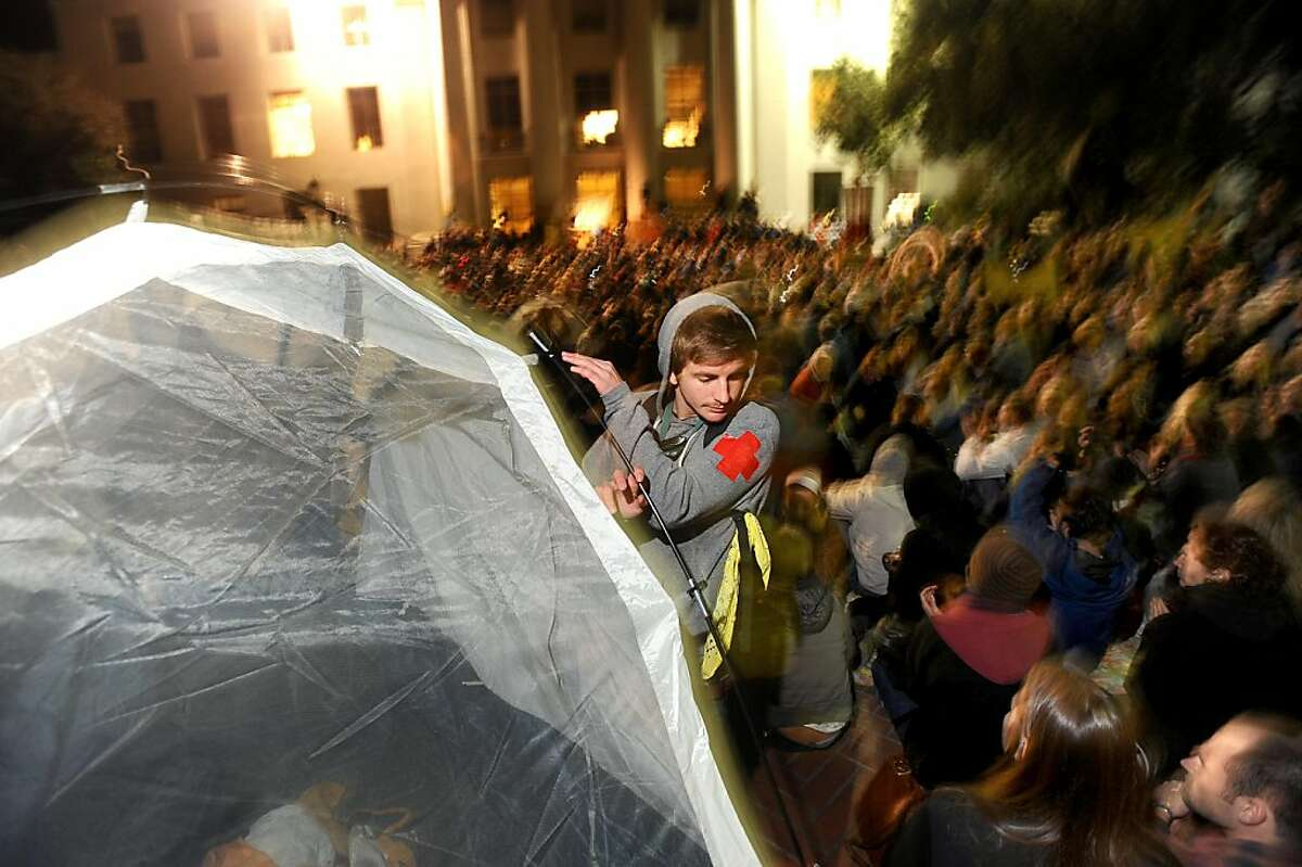 An Occupy Cal medic erects a tent on UC Berkeley's Sproul Plaza to protest education cuts and corporate greed on Tuesday, Nov. 15, 2011, in Berkeley, Calif. Despite police warnings, protesters erected about eight tents in the plaza's center.