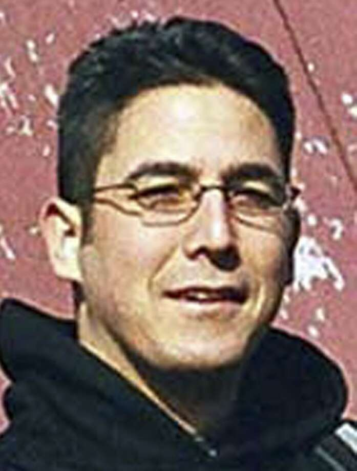 "FILE  -- This is an undated file photo released by the Federal Bureau of Investigation shows Daniel Andreas San Diego, an animal rights activist from Berkeley, Calif.  He was listed on the FBI ""Most Wanted"" terrorist list in connection with bombings of two California drug and cosmetic companies in 2003. FBI officials in Springfield, Mass., are scheduled to make an announcement about the case Wednesday afternoon, Nov. 16, 2011.   (AP Photo/FBI, File) Photo: AP"