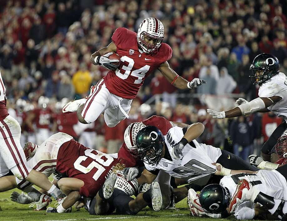 Stanford running back Jeremy Stewart leaps over to score a touchdown against Oregon during the fourth quarter of an NCAA college football game in Stanford, Calif., Saturday, Nov. 12, 2011. (AP Photo/Tony Avelar)  Ran on: 11-17-2011 Fifth-year senior Jeremy Stewart has become Stanford's &quo;closer&quo; when the Cardinal near the goal-line. Ran on: 11-17-2011 Fifth-year senior Jeremy Stewart has become Stanford's &quo;closer&quo; when the Cardinal near the goal-line. Photo: Tony Avelar, AP