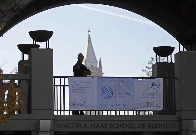 A University of California at Berkeley policeman stands guard at the Haas School of Business Tuesday, Nov. 15, 2011 in Berkeley, Calif.   A man with a gun was shot by police Tuesday inside the business school, after hundreds of students and anti-Wall Street activists descended on the campus for a day of protests about a half mile away. (AP Photo/Ben Margot) Photo: Ben Margot, AP