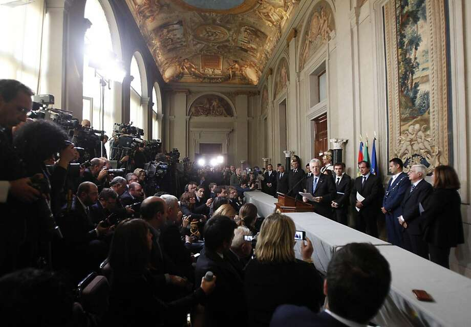 Italian economist Mario Monti, center right, addresses the media at the Quirinale Presidential Palace in Rome, Wednesday, Nov. 16, 2011. Economist Mario Monti announced Wednesday he has formed a new Italian government, opting to put technocrats instead of bickering politicians in his cabinet to enact reforms that can save the country from financial disaster. (AP Photo/Pier Paolo Cito) Photo: Pier Paolo Cito, AP