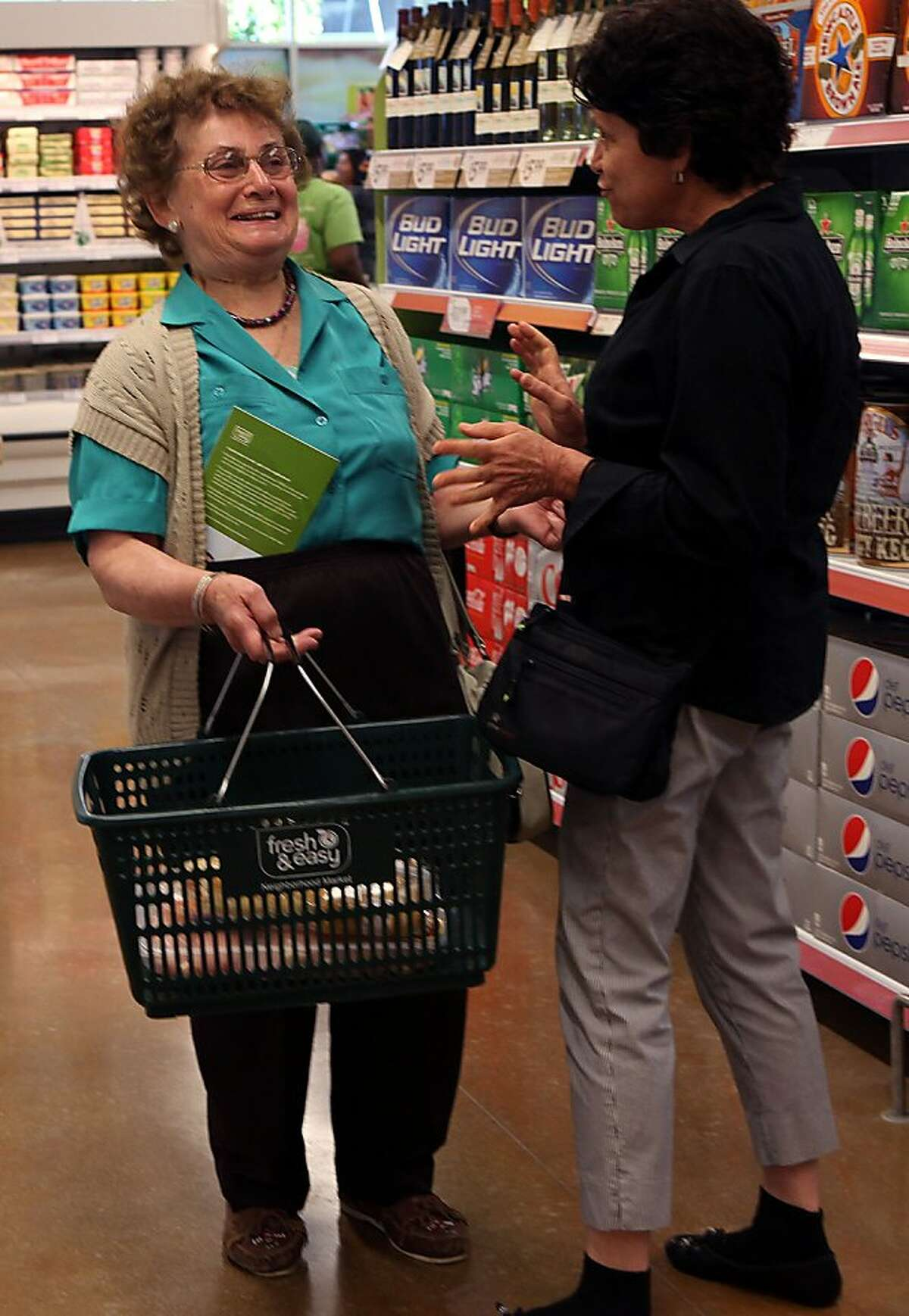 Barbara Fenech (left), commissioner of nearby St. Paul of Shipwreck Church, at the opening of Fresh & Easy Neighborhood Market, the first new grocery store in Bayview-Hunters Point neighborhood in over 20 years in San Francisco, Calif., on Wednesday, August 24, 2011.