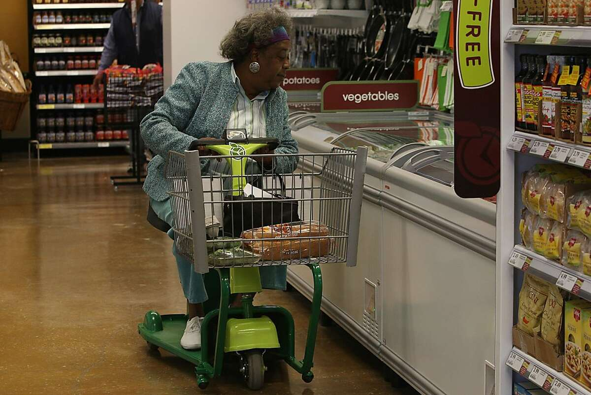 Carolyn Brown from the neighborhood shopping the frozen food section of Fresh & Easy Neighborhood Market, the first new grocery store in Bayview-Hunters Point neighborhood in over 20 years in San Francisco, Calif., on Wednesday, August 24, 2011.