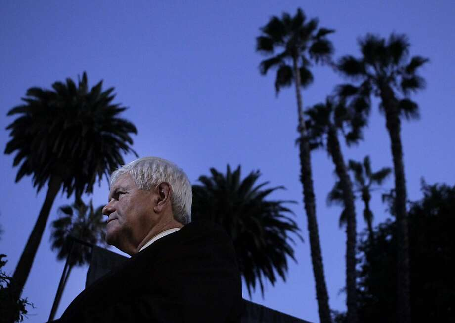 Republican presidential candidate, former House Speaker Newt Gingrich, listens to a question from the media as he arrives for a town-hall-style meeting in Pasadena, Calif., Tuesday, Sept. 6, 2011. (AP Photo/Jae C. Hong) Ran on: 11-17-2011 Newt Gingrich is defending his $1.6 million consulting contract with mortgage giant Freddie Mac. Photo: Jae C. Hong, AP