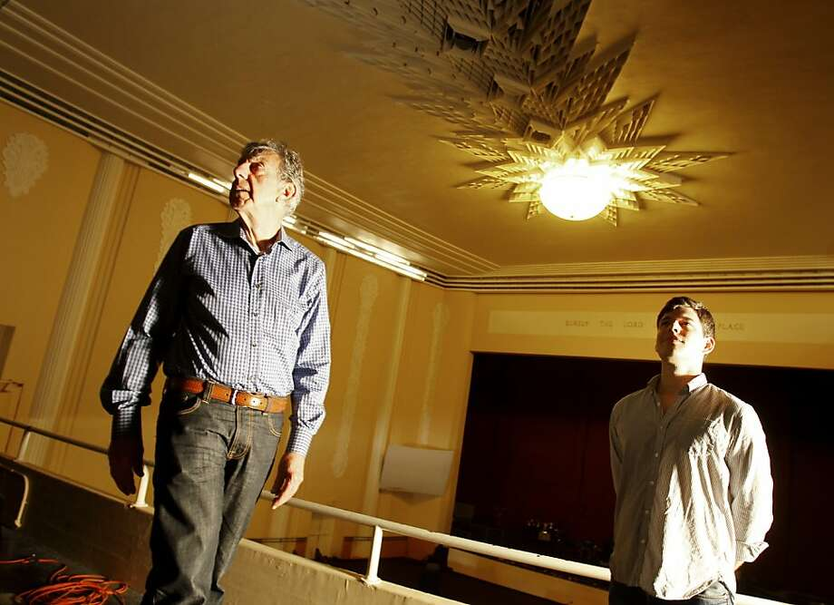 "Dan Weaver (left) and Alex Mullaney check out the view from the Mezzanine. The El Rey Theatre is an art deco movie palace that has been closed as a theatre since 1970 and is currently a church.  Dan Weaver and Alex Mullaney are two locals organizing the screening of ""The Smiling Lieutenant"", the first film screened at the theatre in 1931. Photo: Brant Ward, The Chronicle"
