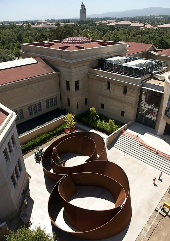 "aerial view of Richard Serra's 2006 weathering steel sculpture ""Sequence"" installed behind Stanford University's Cantor Arts Center    Ran on: 08-07-2011 Above: Riggers use a giant crane to assemble Richard Serra's 2006 weathering steel sculpture &quo;Sequence'' for a temporary installation behind Stanford University's Cantor Arts Center. Left: An aerial view of the 235-ton artwork, which eventually will anchor the SFMOMA home of the Fisher collection. Photo: Linda Cicero, Stanford University News Dept."
