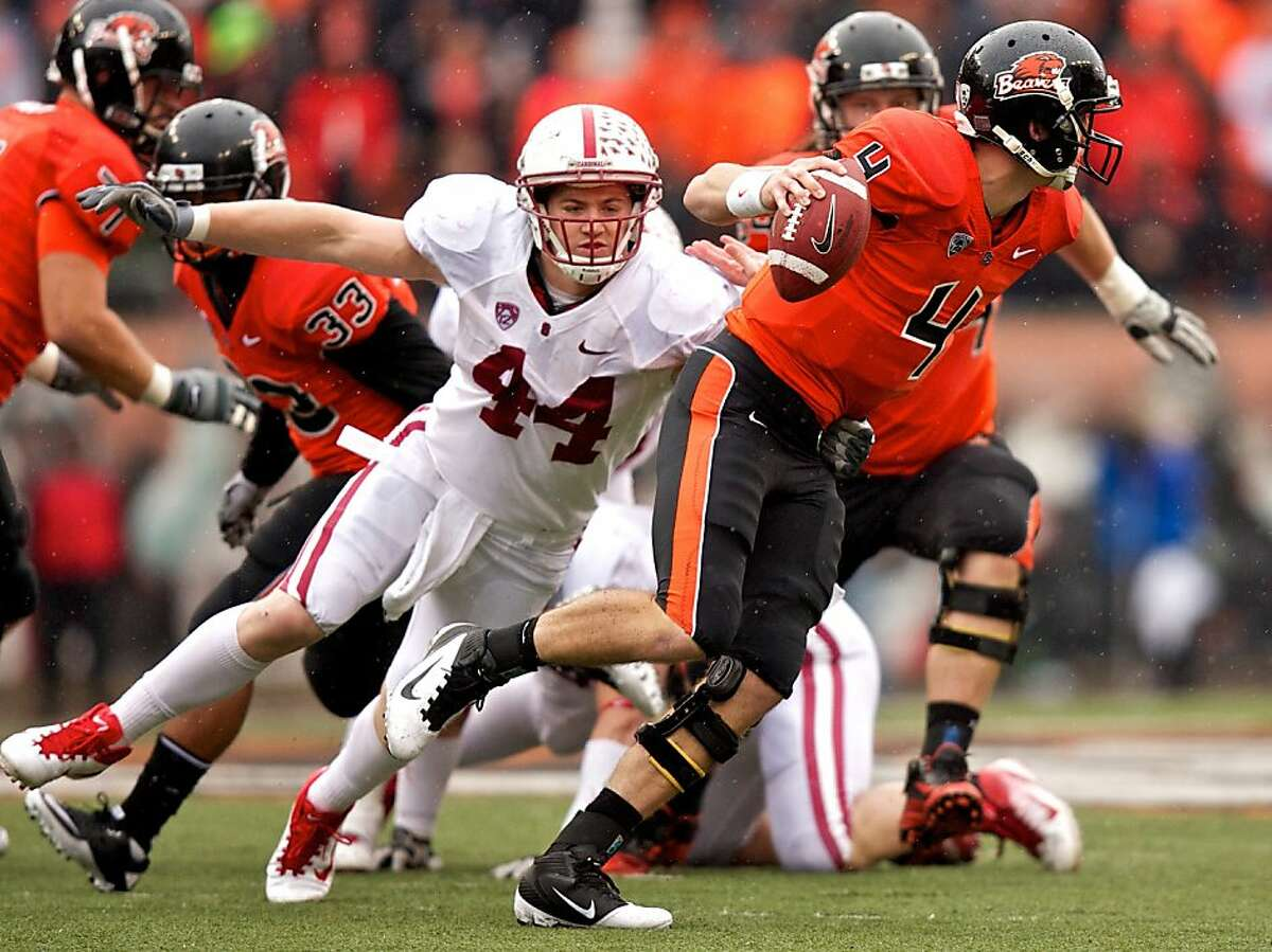 CORVALLIS, OR - NOVEMBER 5: Linebacker Chase Thomas #44 of the Stanford Cardinal sacks quarterback Sean Mannion #4 of the Oregon State Beavers on November 5, 2011 at Reser Stadium in Corvallis, Oregon. Stanford won the game 38-13. (Photo by Craig Mitchelldyer/Getty Images)