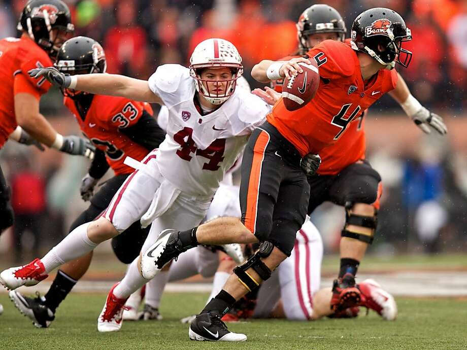 CORVALLIS, OR - NOVEMBER 5: Linebacker Chase Thomas #44 of the Stanford Cardinal sacks quarterback Sean Mannion #4 of the Oregon State Beavers on November 5, 2011 at Reser Stadium in Corvallis, Oregon. Stanford won the game 38-13. (Photo by Craig Mitchelldyer/Getty Images) Photo: Craig Mitchelldyer, Getty Images