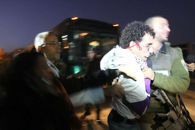 An activist is forcibly removed from a bus as Palestinians today, Tuesday, November 15, 2011, adopted a new tactic in their confrontations with Israeli authorities in the West Bank, boarding buses intended for Jewish settlers in what they say is an effort to emulate the civil rights movement in the United States. Israeli authorities pulled the six riders from the bus when it reached a checkpoint outside Jerusalem. (Maya Levin/MCT) Photo: Maya Levin, MCT