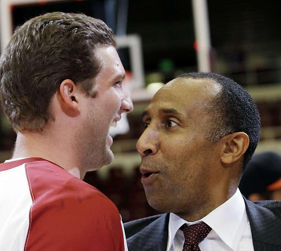 Stanford head coach Johnny Dawkins, right, hugs forward Andy Brown following their NIT Season Tip-Off college basketball game against Colorado State, Tuesday, Nov. 15, 2011, in Stanford, Calif. Stanford won 64-52. (AP Photo/Paul Sakuma) Photo: Paul Sakuma, AP
