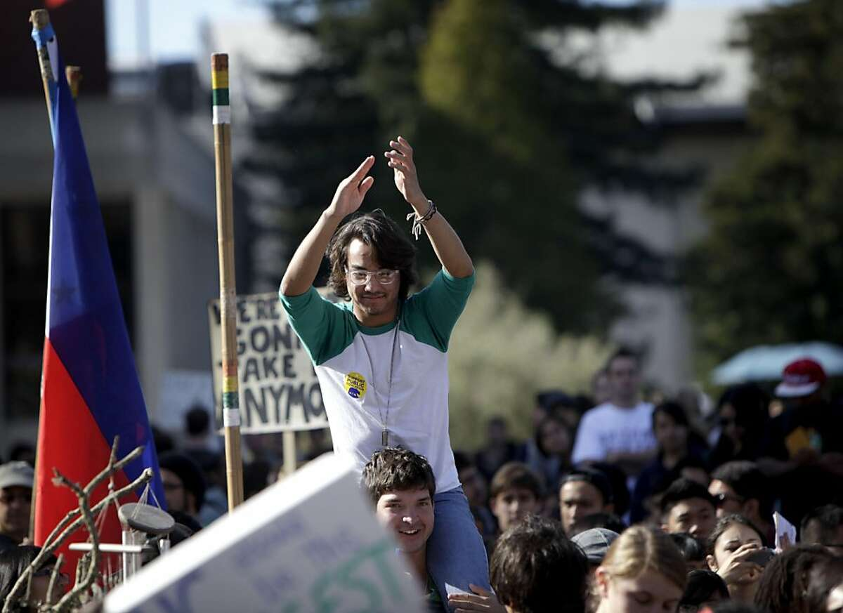 """Andrew Mayeda, 19-years old, join in with the thousand of peoplein on a statewide student strike at Sproul Plaza at UC Berkeley, Tuesday November 15, 2011 to protest the raising of tuition fee in Berkeley, Calif. """"Social movement is what makes politicians hear you,"""" says Mayeda, a political science major at UC."""