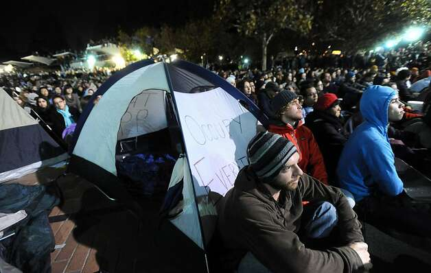 Protester Alex Schuknecht joins thousands of people, and about eight tents, on UC Berkeley's Sproul Plaza to protest education cuts and corporate greed on Tuesday, Nov. 15, 2011, in Berkeley, Calif. Schuknecht is a third year graduate student at UC Berkeley. Photo: Noah Berger, Special To The Chronicle