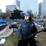 Sgt. Steve Suchon, an Alameda County sheriff's deputy, maintains a perimeter around Frank Ogawa Plaza following a police raid on Occupy Oakland on Monday, Nov. 14, 2011, in Oakland, Calif.