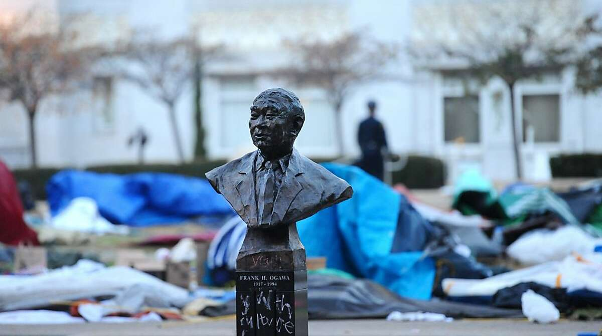 A bust of Frank Ogawa is the sole remaining inhabitant of central Frank Ogawa Plaza following a police raid at Occupy Oakland on Monday, Nov. 14, 2011, in Oakland, Calif.