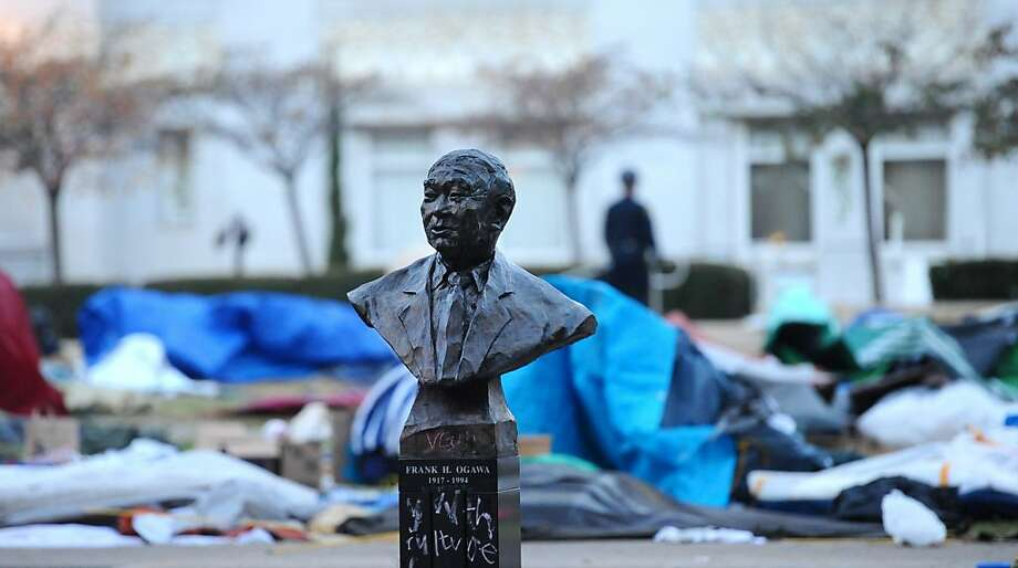 A bust of Frank Ogawa is the sole remaining inhabitant of central Frank Ogawa Plaza following a police raid at Occupy Oakland on Monday, Nov. 14, 2011, in Oakland, Calif. Photo: Noah Berger, Special To The Chronicle