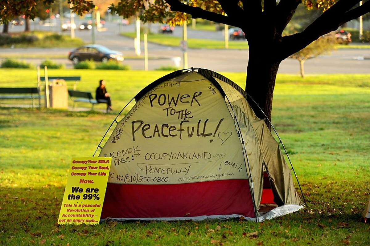 A protester's tent sits beneath a tree at Snow Park on Monday, Nov. 14, 2011, in Oakland, Calif. Although police leveled Occupy Oakland's City Hall encampment early this morning, they left the group's camp near Lake Merritt untouched.