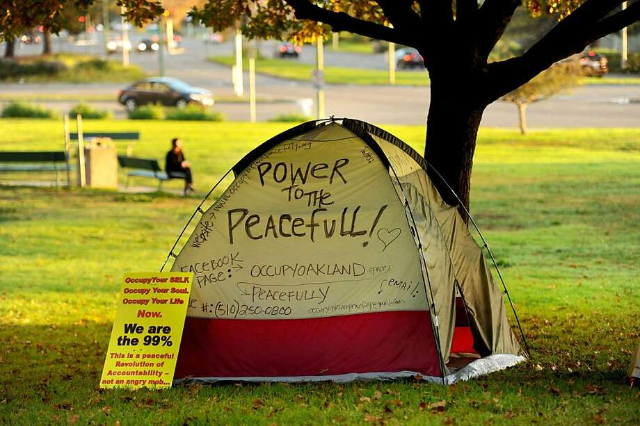 A protester's tent sits beneath a tree at Snow Park on Monday, Nov. 14, 2011, in Oakland, Calif. Although police leveled Occupy Oakland's City Hall encampment early this morning, they left the group's camp near Lake Merritt untouched. Photo: Noah Berger, Special To The Chronicle