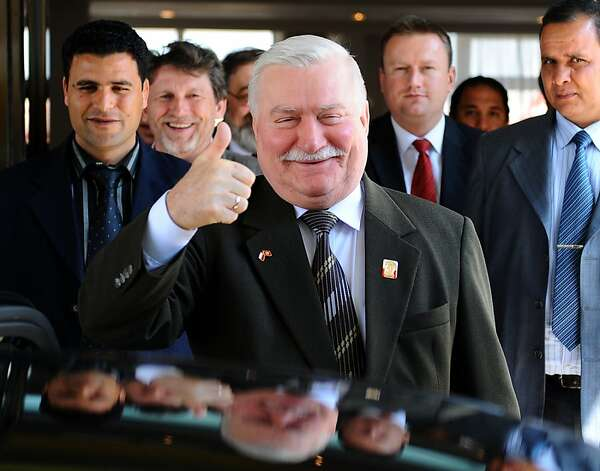 Polish former President Lech Walesa (C) smiles as he gestures upon his arrival in Tunis on April 28, 2011. Walesa is on a two-day official visit to Tunisia at the invitation of an interim administration which took charge after January's toppling of president Zine el Abidine Ben Ali.  AFP PHOTO / FETHI BELAID (Photo credit should read FETHI BELAID/AFP/Getty Images) Photo: Fethi Belaid, AFP/Getty Images
