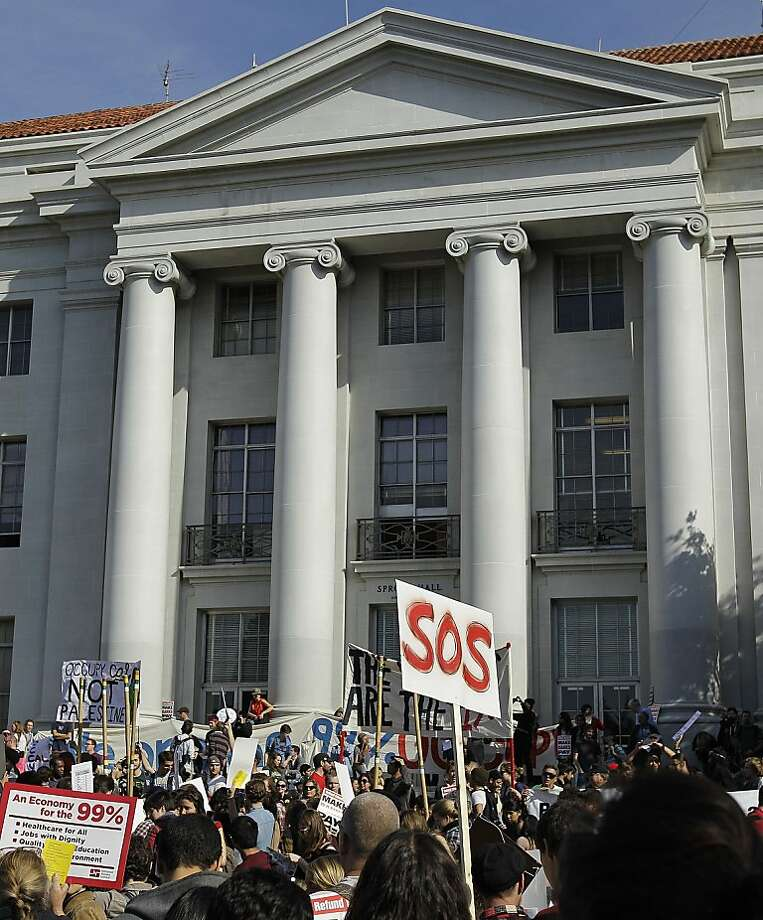 "Student activists from the University of California at Berkeley rally at Sproul Plaza Wednesday, Nov. 9, 2011, in Berkeley, Calif. Students are planning to set up an ""Occupy Cal"" camp on campus despite official warnings that such encampments are not allowed. These activists joined students across California in calling to make banks pay to end cuts to higher education. (AP Photo/Ben Margot) Photo: Ben Margot, AP"