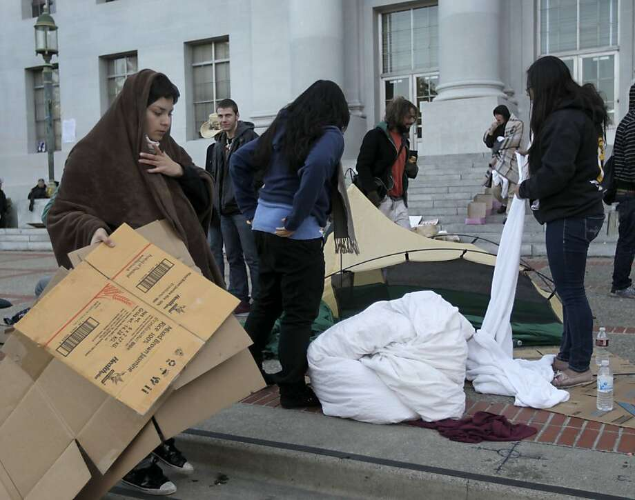 Protesters pack up after spending the night in the Occupy Cal camp on the steps of Sproul Hall at UC Berkeley on Thursday, Nov. 10, 2011. Students are angry over soaring tuition fees. Photo: Paul Chinn, The Chronicle